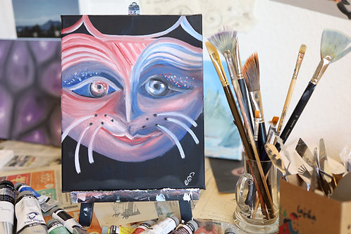 Cheshire cat in red and blue