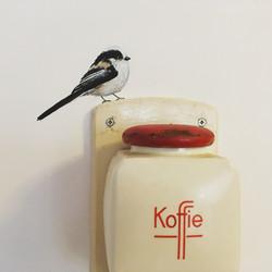 Staartmees op koffiemolen