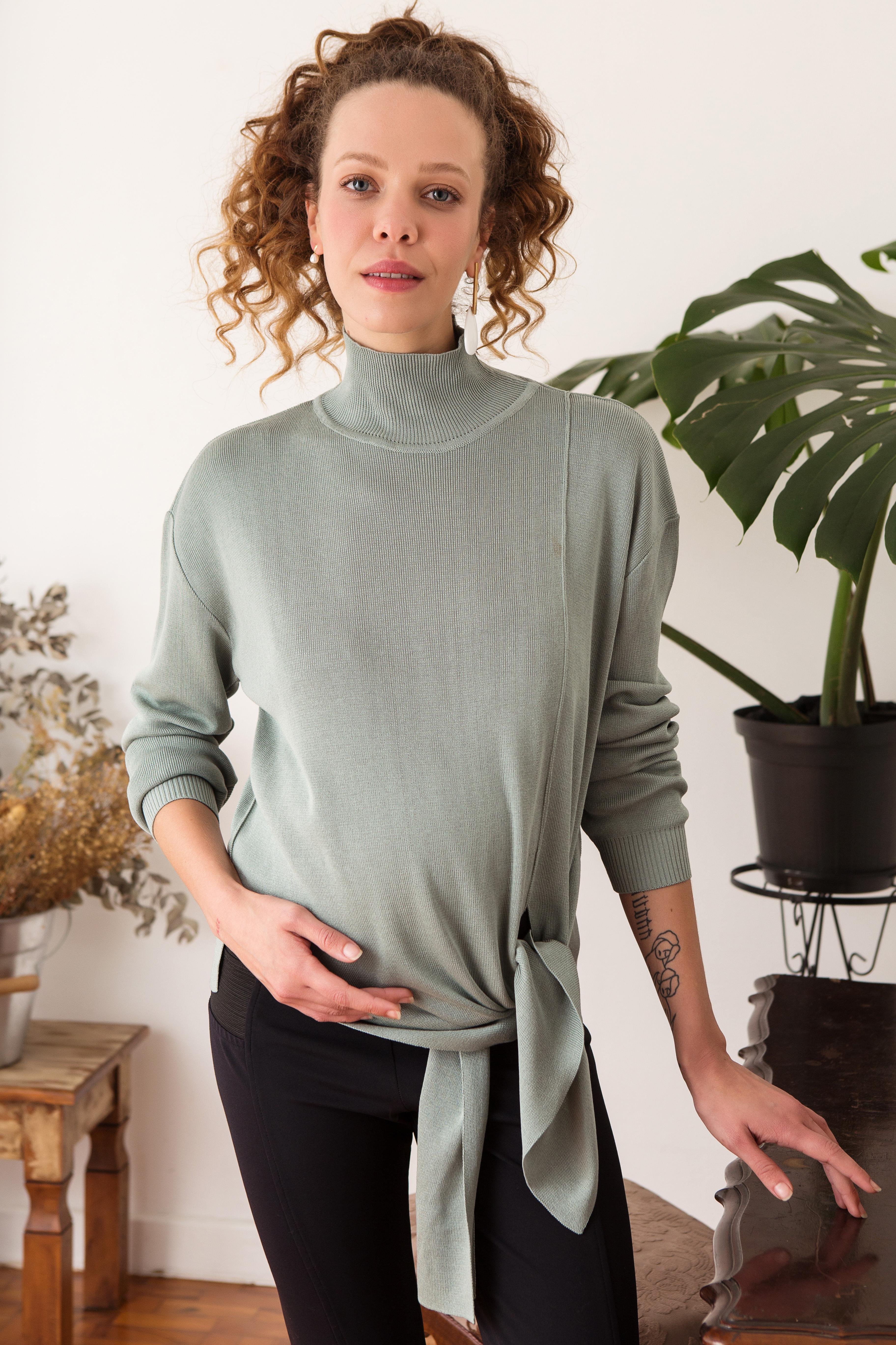 trico verde água com nó