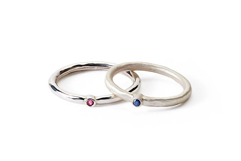 Hammered silver rings with rubover set ruby or sapphire
