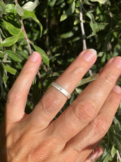 Hammered silver rings with tiny diamond