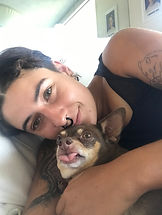 Heather from PetProGo Los Angeles laying with brown short-haired dog on couch