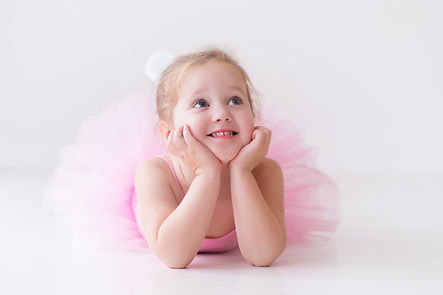 Little ballerina girl in a pink tutu. Ad