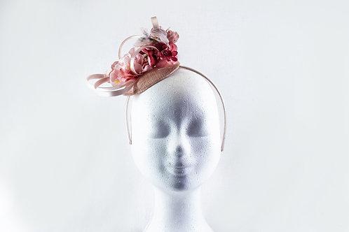 Lief roze fascinator  met veel bloemetjes