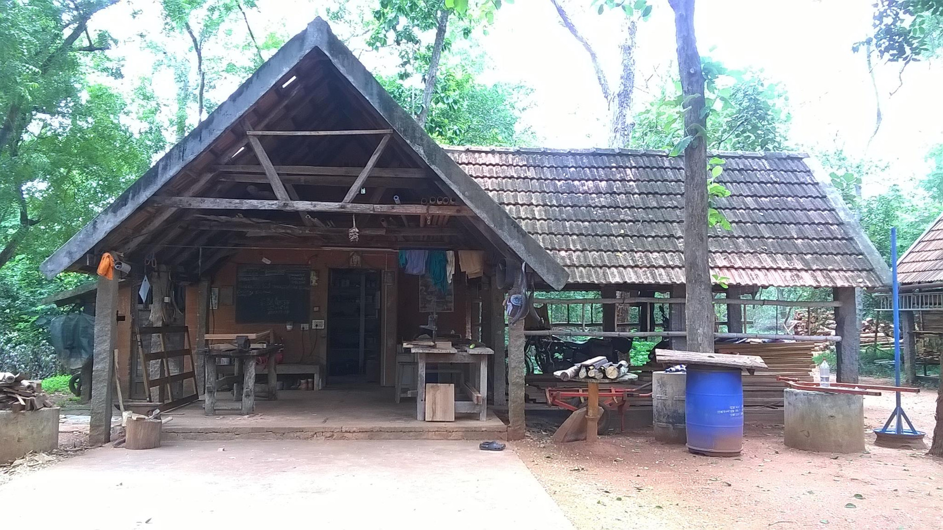low teck workshop set in the forest