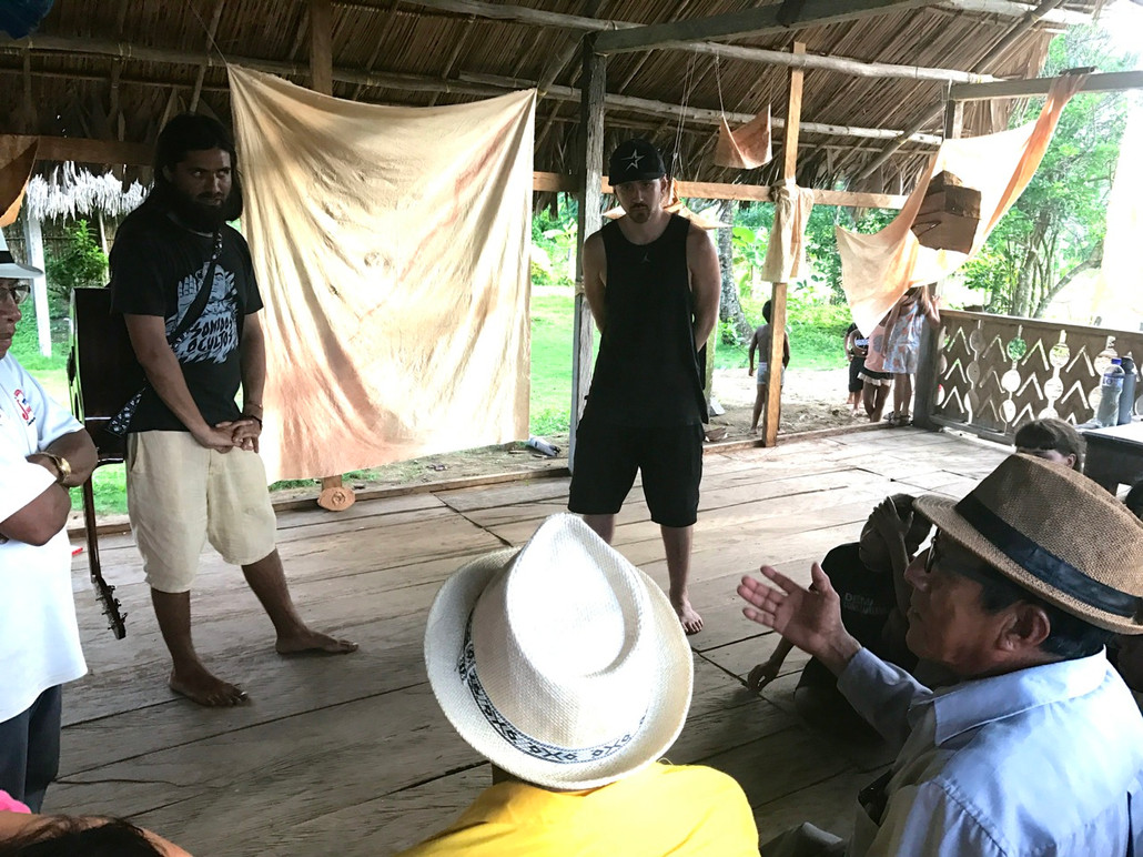 Quincy visiting the village of Armilla, in the remote island of Guna Yala, Panama, as part of a cultural-exchange. He is recieving feedback and guidance from village elders after performing his writing and lyricism work.