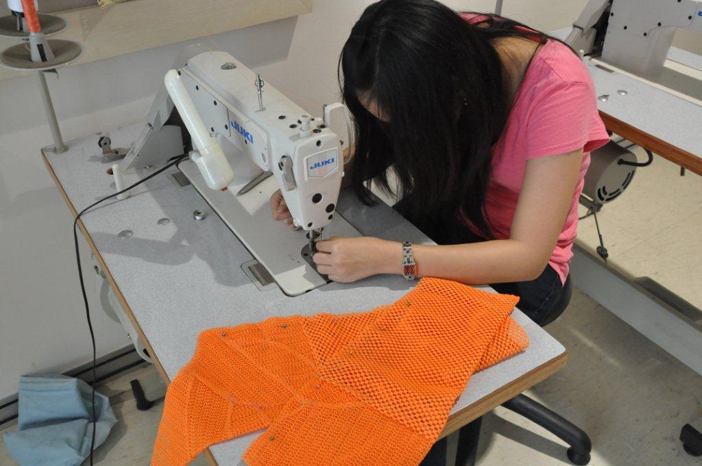 06 Student sewing the Tiger costume for the show.JPG.JPG