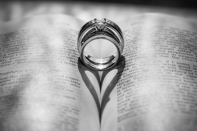 Wedding Rings Make Heart on Bible