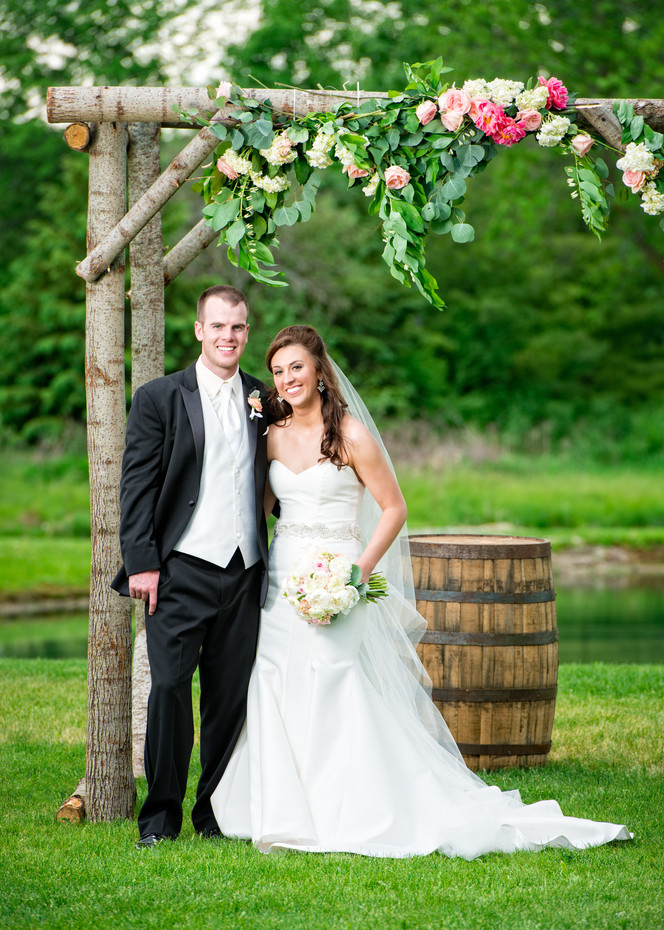 Spring Wedding Portrait Under Rustic Arch