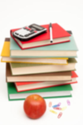 pile of books with apple.jpg