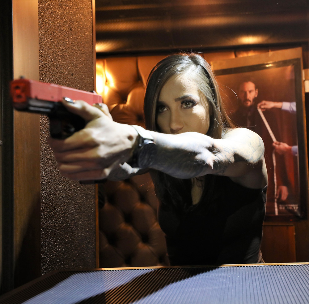 Jacqueline Carrizosa training on Milo with the SIRT pistol