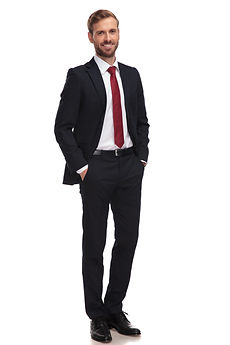 relaxed businessman smiling and standing