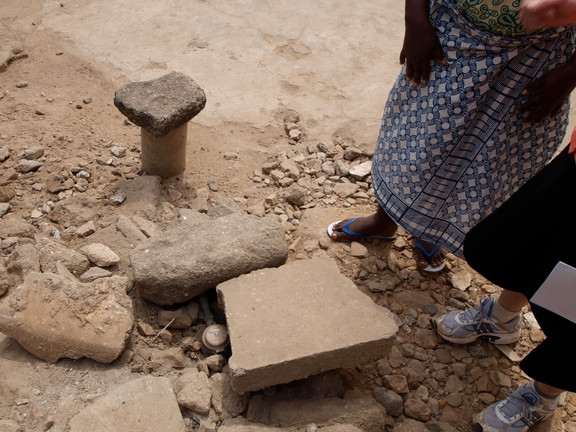 A pipe covered with a loose piece of cement in Accra.