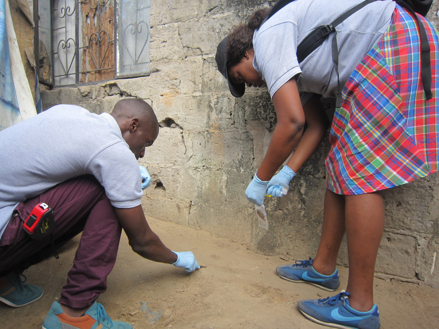 The Maputo field team collecting a soil sample.