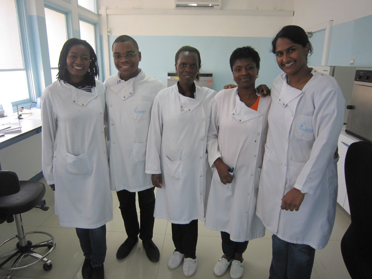The laboratory team in Maputo and SaniPath's Associate Director of Research Projects, Suraja Raj (pictured right), pose for a picture in their lab coats.