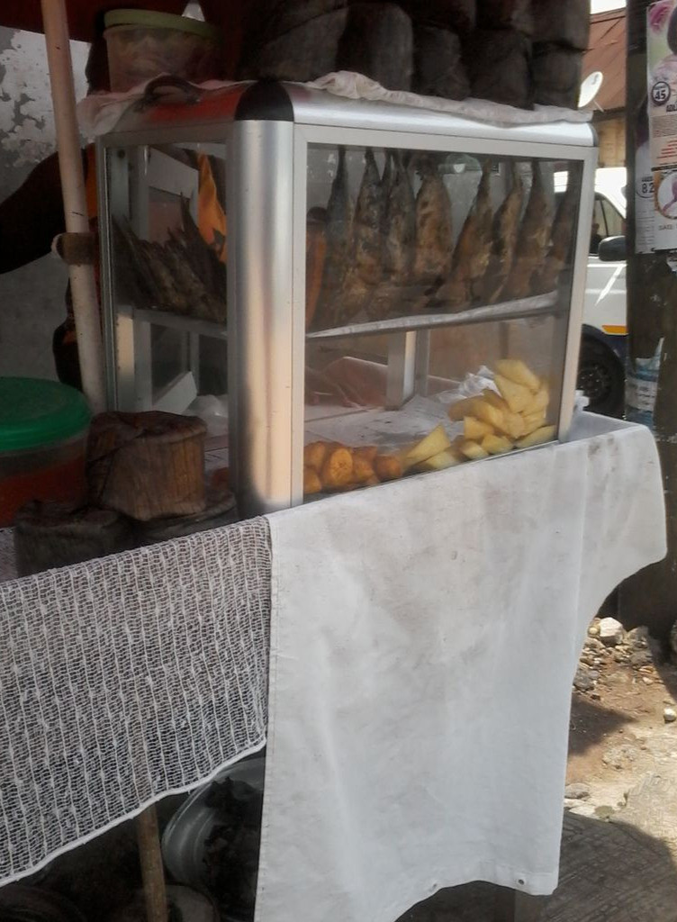 A street food vendor in Kumasi where a sample is collected.