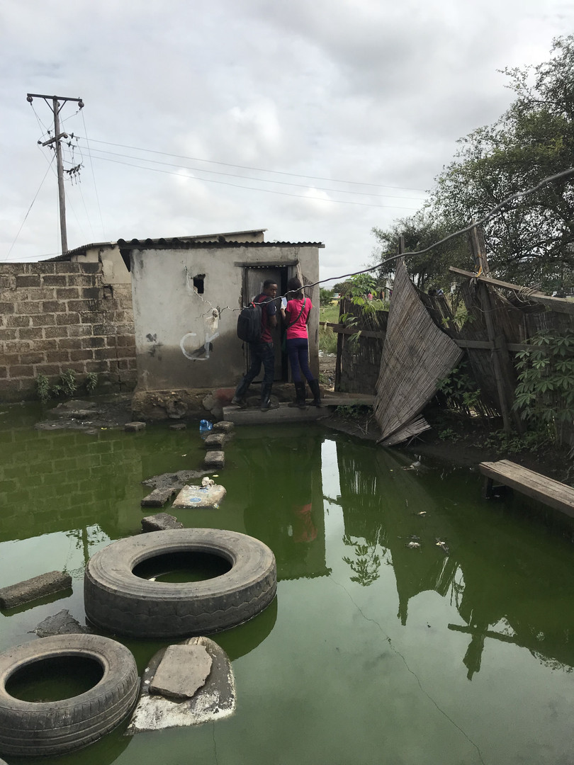 This picture of the standing water in Lusaka shows how citizens have used materials in an attempot to avoid walking directly through floodwater.