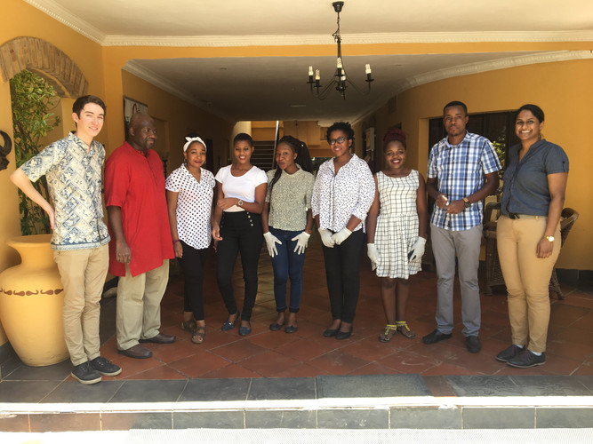 The Lusaka staff pose for a picture after a full day of training.