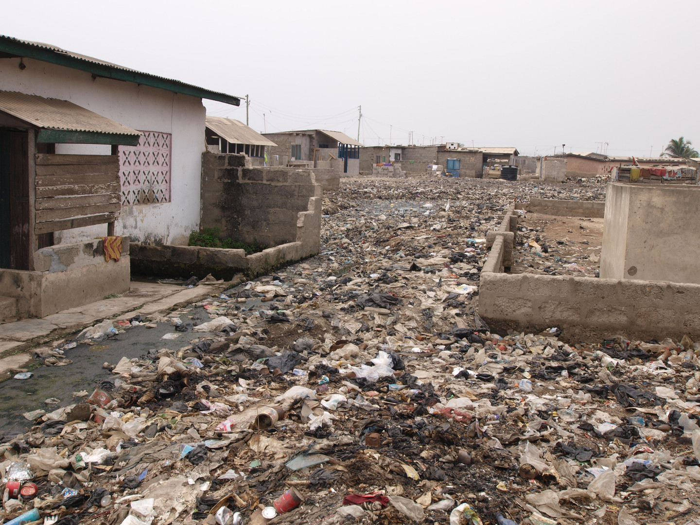Trash and floodwater in a crowded neighborhood in Accra.