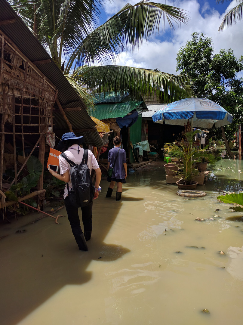The team treks through floodwater as they navigate the neighborhoods in Siem Reap where the SaniPath Tool will be deployed.
