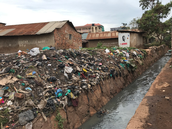 Trash heaps on the banks of a stream in Kampala.