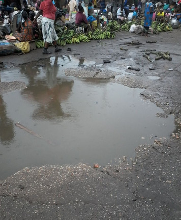Standing floodwater near a market in Kumasi.