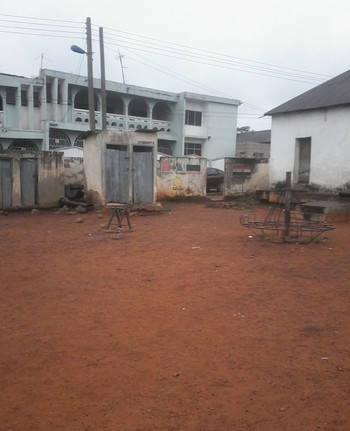 Soil samples are collected from this school yard near public toilets to measure potential fecal contamination in the soil that children may be exposed to.
