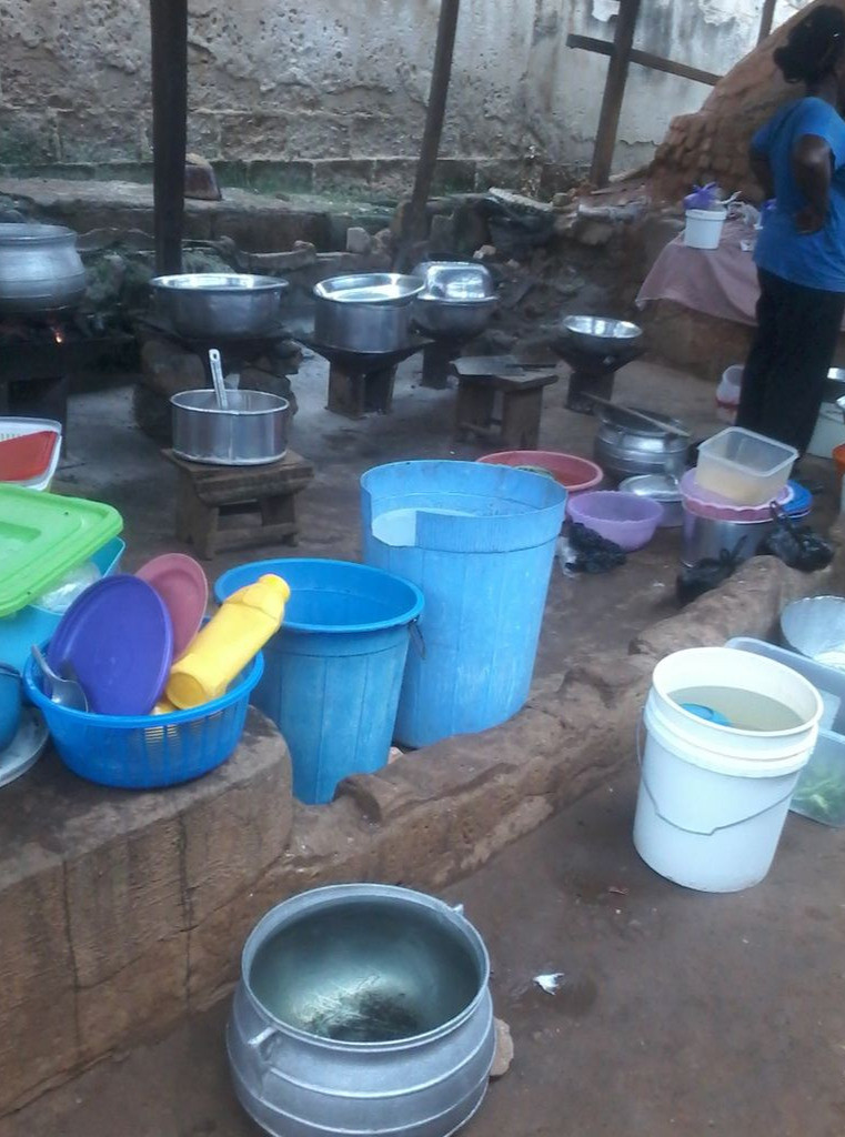 An area used for for communal dishwashing and cooking.