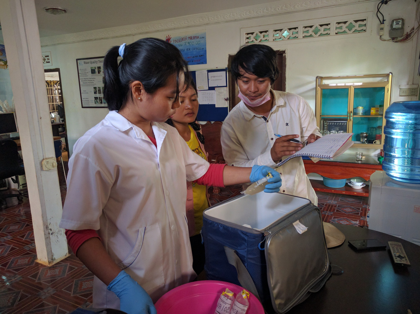 Staff in the Siem Reap prepare their samples for testing in the lab.