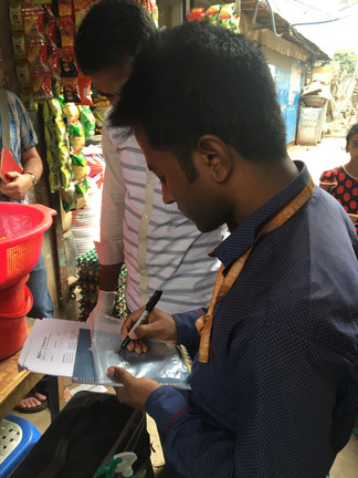 Street food is a common pathway for fecal exposure. Here you can see the field staff is collecting samples from a street food vendor in Dhaka.