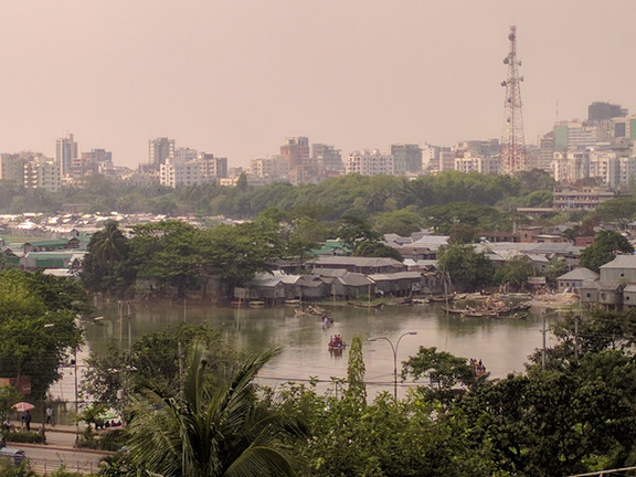 Surface water in Dhaka, Bangladesh. Notice how close the housing is to the water. Toilets often discharge directly into this open water.