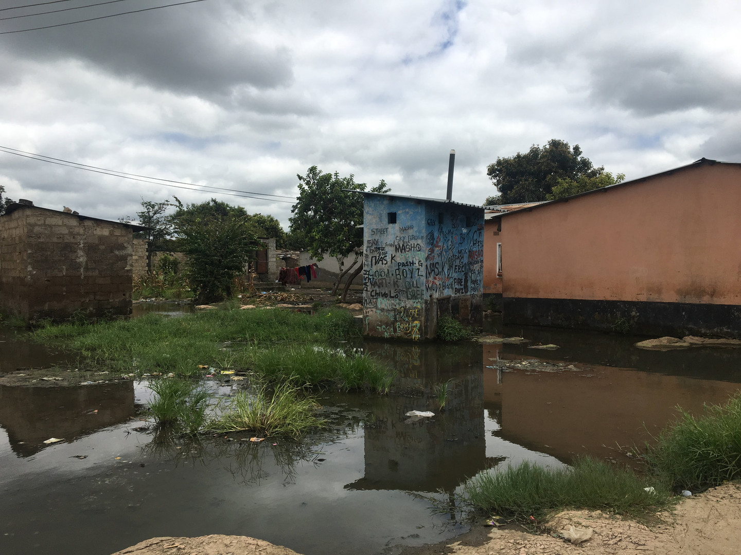A flooded latrine like this one in Lusaka will be sampled for E. coli in the surrounding waters.