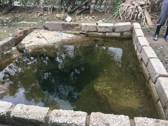 This shallow well in Lusaka is an example of a water supply pathway that will be sampled during a deployment of the SaniPath Exposure Assessment Tool. Notice that the water supply is uncovered, allowing for potential pollution and microorganisms to enter and contaminate the water.