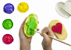 Childs hand, play painting with potato s