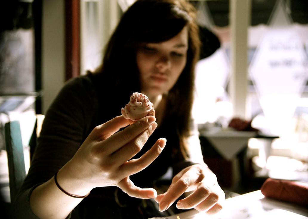 artist handling seashell
