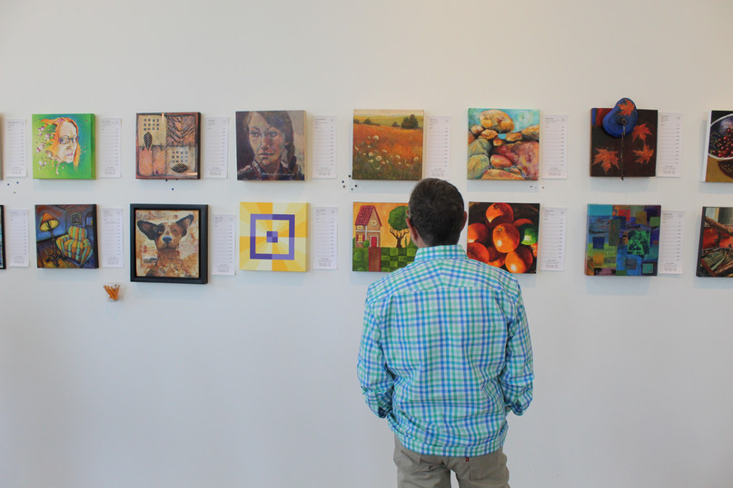 man observing art