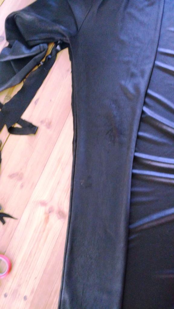 Cutting the black fabric