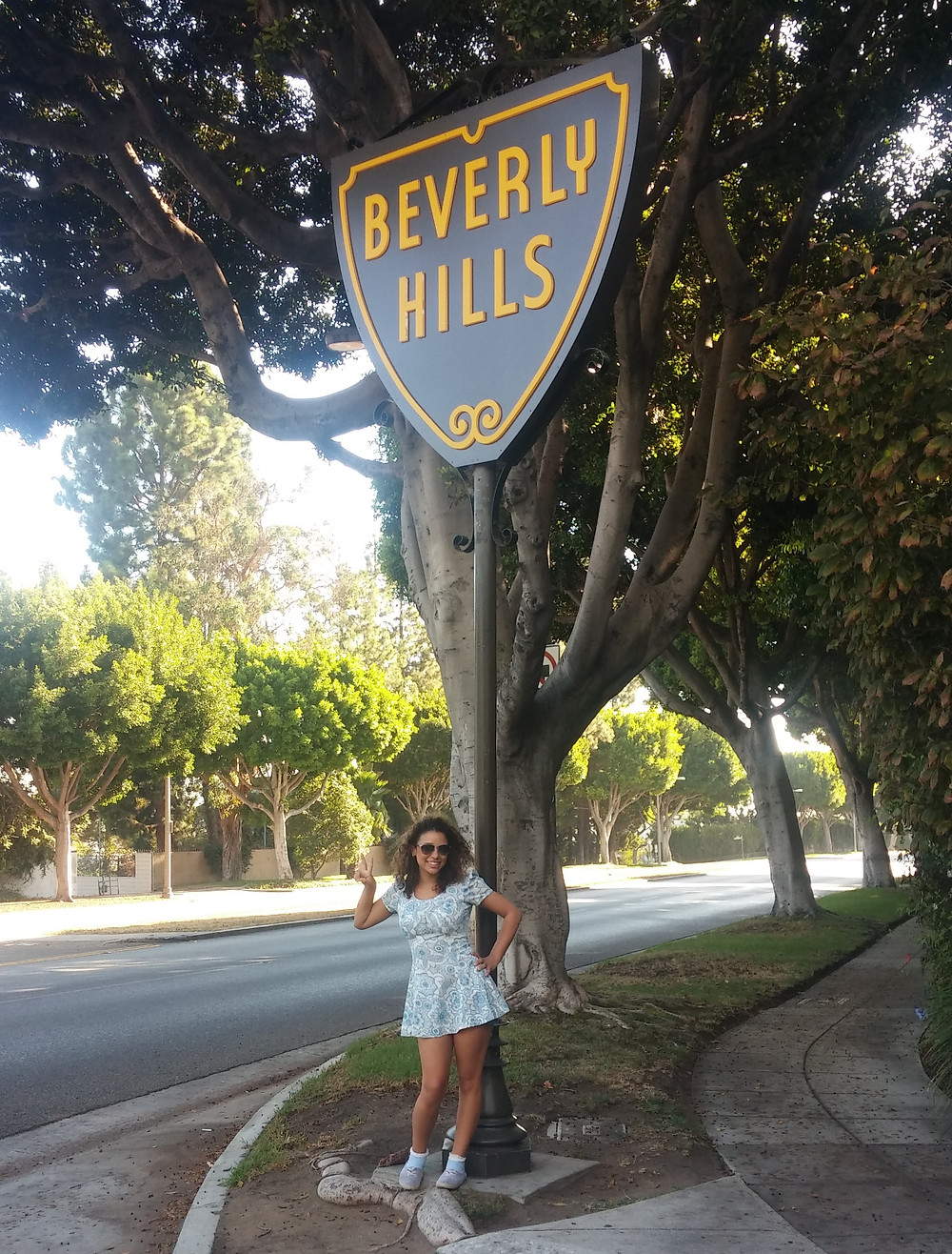 Standing in front of the Beverly Hills sign in Los Angeles