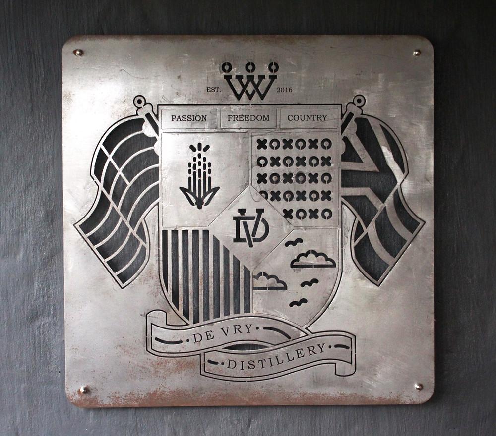 De Vry Distillery crest