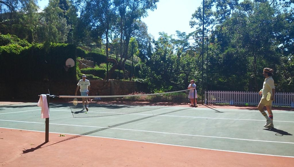 The suitors playing a tennis match