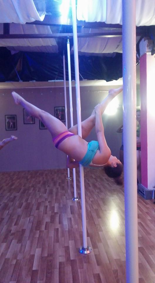 Allegra pole dancing pose