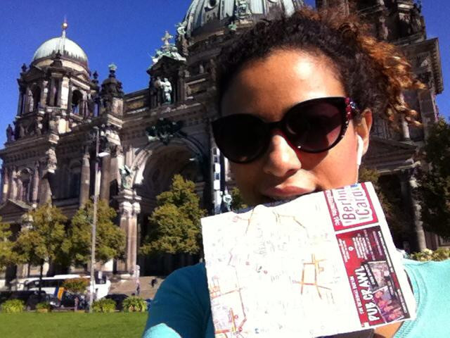 Holding a map while lost in Berlin