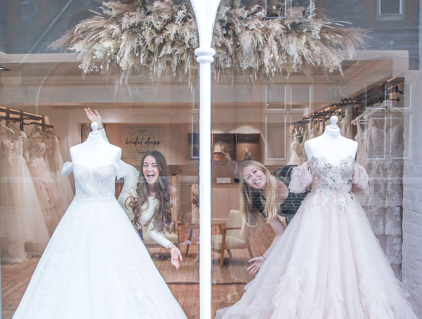 Wedding dress store front and the ladies who run the bridal shop