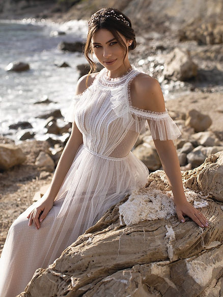 a bohemian inspired wedding dress that is stock in the bridal boutique