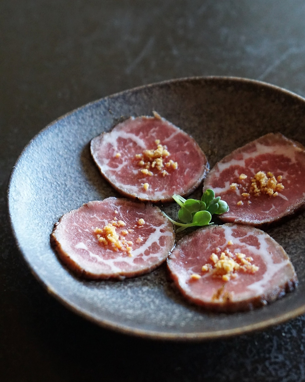USDA Prime Ribeye Tataki with Ponzu and Japanese Cherry Blossoms.