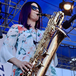 Leigh Pilzer playing baritone saxophone at the Newport Jazz Festival with The DIVA Jazz Orchestra