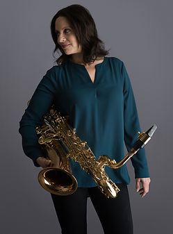 Leigh Pilzer with her baritone saxophone by Jon Barnes Photography