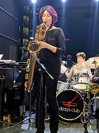 Leigh Pilzer playing baritone saxophone with The DIVA Jazz Orchestra at Dizzy's. Photo by Marcia Gallas-Christie.