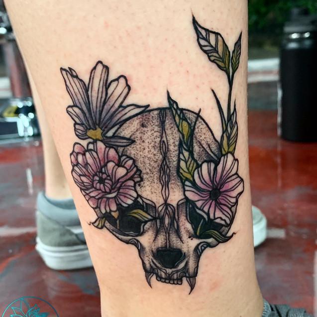 Cat skull with flowers tattoo