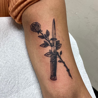 Dagger and rose tattoo